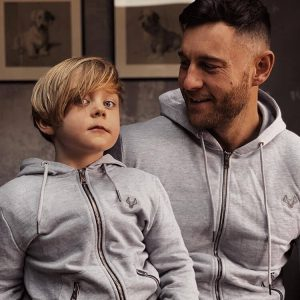 Father and son wearing matching hoodies
