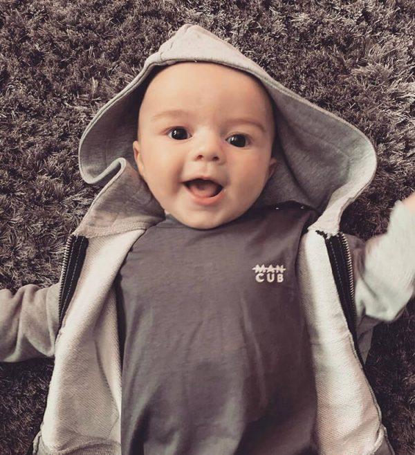 Cub wearing MANCUB t-shirt and hoodie