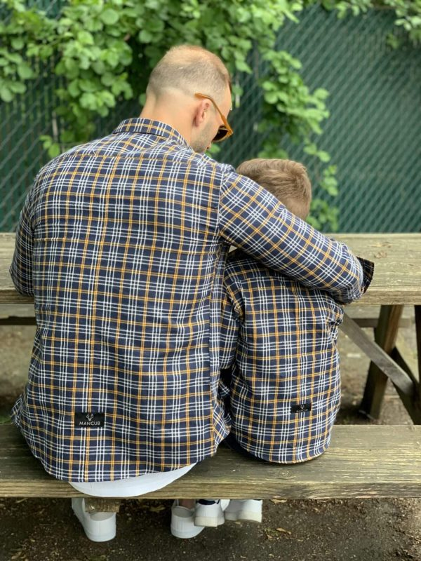Dad and son in matching MANCUB shirts